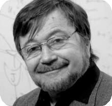 man with glasses and facial hair in black and white head shot