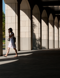 Engineering Quad Colonnade - woman walking through arched arcade
