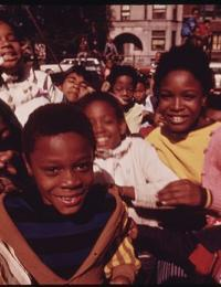 group of black school children wait in a crowded playground