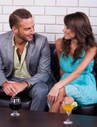 young couple sitting together on couch
