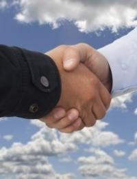 two people shaking hands as if making an agreement