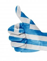 thumbs up overlayed with colors of the Greek flag