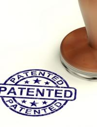 """blue stamp on paper reading """"patented"""""""
