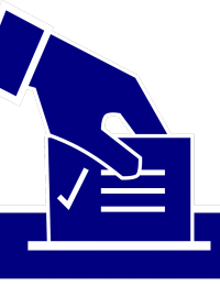 dropping ballot into voting box